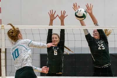 Woodstock's Emma Brand (right) makes a block against Woodstock North's Brooke Amann Wednesday, September 18, 2019 at Woodstock North High School. Woodstock gets the win in two sets.