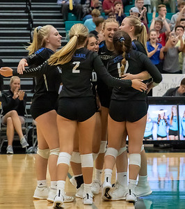 Woodstock celebrates the two set victory over Woodstock North Wednesday, September 18, 2019 at Woodstock North High School.
