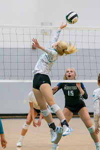 Woodstock North's Kylie Schulze redirects the ball against Woodstock Wednesday, September 18, 2019 at Woodstock North High School. Woodstock gets the win in two sets.