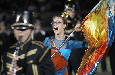 Candace H. Johnson-For Shaw Media Grayslake North's Autumn Bush performs with the Color Guard in the Marching Band at half-time during the varsity football game against Antioch at Grayslake North High School. (9/13/19)