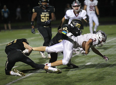 Candace H. Johnson-For Shaw Media Antioch's Gavin Calabrese (#3) is tackled by Grayslake North's Tommy Keilwitz and Tayo Oladunmoye in the second quarter at Grayslake North High School. Antioch won 38-0. (9/13/19)