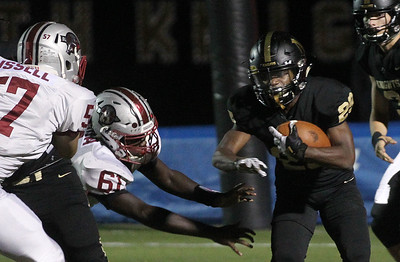 Candace H. Johnson-For Shaw Media Grayslake North's Christian Johnson (#29) escapes the tackle by Antioch's Elkanah Gahima (#61) in the fourth quarter at Grayslake North High School. Antioch won 38-0. (9/13/19)