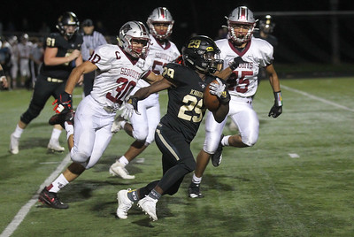 Candace H. Johnson-For Shaw Media Grayslake North's Christian Johnson is surrounded by Antioch defenders as he carries the ball in the third quarter at Grayslake North High School. Antioch won 38-0. (9/13/19)