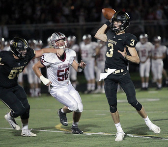 Candace H. Johnson-For Shaw Media Grayslake North's Josh West helps his quarterback Nick Fish (#3) deliver a pass against Antioch's Lucas Bentley (#50) in the second quarter at Grayslake North High School. Antioch won 38-0. (9/13/19)