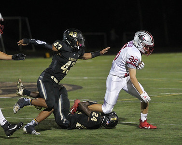 Candace H. Johnson-For Shaw Media Antioch's Andrew Bowles (#26) is tackled by Grayslake North's Dimitri Cannon and Maalek Wilson in the third quarter at Grayslake North High School. Antioch won 38-0. (9/13/19)