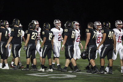Candace H. Johnson-For Shaw Media The Antioch varsity football team greets Grayslake North at the end of their game at Grayslake North High School. Antioch won 38-0. (9/13/19)