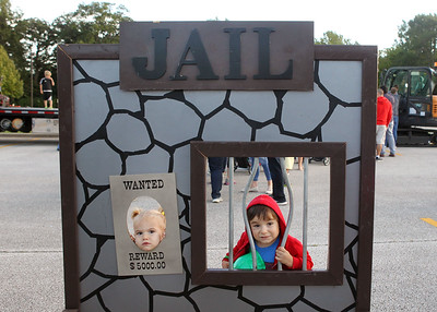 Candace H. Johnson-For Shaw Media Lucy Carlson, 2, of Gurnee and her brother, Oakley, 4, have some fun looking out of a make-believe jail during the Gurnee Park District's 10th Annual Touch-A-Truck at the Hunt Club Park Community Center in Gurnee. (9/13/19)