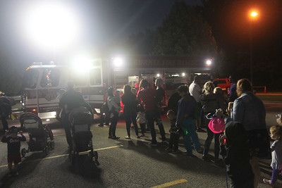 Candace H. Johnson-For Shaw Media Parents and their children wait in line to check out a Gurnee Fire Department Squad during the Gurnee Park District's 10th Annual Touch-A-Truck at the Hunt Club Park Community Center in Gurnee. (9/13/19)