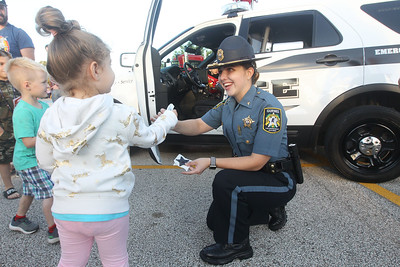 Candace H. Johnson-For Shaw Media Zara Shamon, 3, of Lindenhurst gets a sticker from Stephanie Auth, with the Gurnee Police Explorer Post 266, during the Gurnee Park District's 10th Annual Touch-A-Truck at the Hunt Club Park Community Center in Gurnee. (9/13/19)
