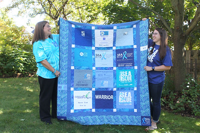 Candace H. Johnson-For Shaw Media Nancy Gould-O'Brien and her daughter, Shannon, 23, talk about the quilt of t-shirts made in honor of her father, Russ Gould, founder of an event called the SEA Blue Prostate Cancer 5K Run/Walk, at their home in Grayslake.The annual walk took place in Chicago on September 15th. (9/16/19)