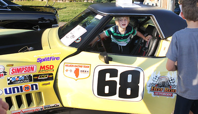 Candace H. Johnson-For Shaw Media Jonah Duval, 3, of Wauconda is not happy to get out of a 1968 Corvette to let his brother, Eli, 7, get in during Wauconda Cruise Night on Main Street in Wauconda. Mark Klopack, of Schiller Park with Hot Rod Autobody, brought the car to the event. (9/17/19)