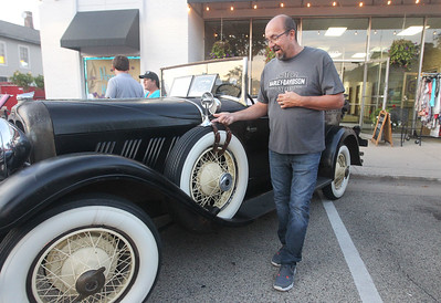 Candace H. Johnson-For Shaw Media Chuck McCarthy, of Wauconda shows a factory option of a rear view mirror strapped onto a spare tire on his 1930 Auburn 8-95 Phaeton-Sedan during Wauconda Cruise Night on Main Street in Wauconda. In 1930 the car was relatively expensive to buy for $1395.00. (9/17/19)