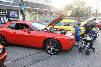 Candace H. Johnson-For Shaw Media Michael Milone, of Antioch and his sons, Mikey, Jr., 8, and Joey, 4, look at a 2008 Dodge Challenger during Wauconda Cruise Night on Main Street in Wauconda. (9/17/19)