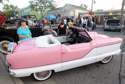 Candace H. Johnson-For Shaw Media Tracy McCarthy talks with Carolyn Stern, both of Wauconda and Janet Groberski, of Cocoa Beach, Fla. about her 1959 Nash Metropolitan Convertible during Wauconda Cruise Night on Main Street in Wauconda. McCarthy found her car on Craigslist.(9/17/19)