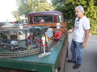 Candace H. Johnson-For Shaw Media Larry Baron, of Brookfield uses a controller to operate the sound of his Rio Grande G-scale model train which sits in in the back of his 1949 Chevy pickup truck during Wauconda Cruise Night off of Main Street in Wauconda. (9/17/19)