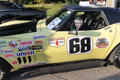 Candace H. Johnson-For Shaw Media Jonah Duval, 3, of Wauconda is all smiles as he sits in a 1968 Corvette during Wauconda Cruise Night off of Main Street in Wauconda. Mark Klopack, of Schiller Park with Hot Rod Autobody brought the car to the event. (9/17/19)