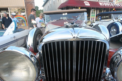 Candace H. Johnson-For Shaw Media Matthew Harkin, 21, of Round Lake and his father, Kevin, look at a Duesenberg during Wauconda Cruise Night on Main Street in Wauconda. (9/17/19)