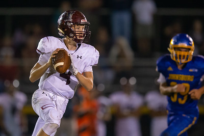 Marengo quarterback Mitchell Kunde rolls out for a pass against Johnsburg Friday, September 20, 2019 in Johnsburg. Marengo over the Skyhawks 33-0.