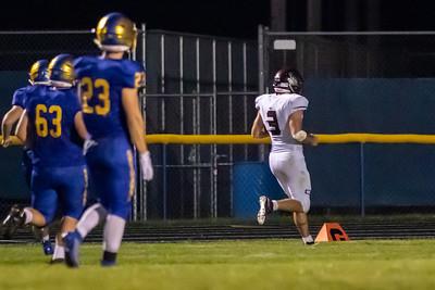 Marengo's Finn Schirmer runs back an interception for a touchdown against Johnsburg Friday, September 20, 2019 in Johnsburg. Johnsburg is shutout for the third time in four games 33-0.