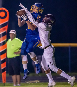 Johnsburg's Gavin Boal intercepts the pass in front of Marengo's Cole Davis Friday, September 20, 2019 in Johnsburg. Marengo gets the win 33-0.