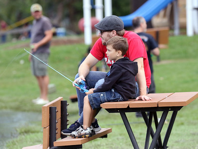 Candace H. Johnson-For Shaw Media Cody Lipscomb, of Huntley helps his son, Nate Gilani, 6, of Fox Lake fish during the 3rd Annual Fox Lake Fish Fest Youth Fishing Derby at Lakefront Park in Fox Lake. (9/20/19)