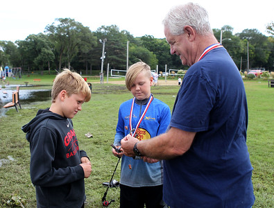 Candace H. Johnson-For Shaw Media Anthony Koza, of Fox Lake and Caleb Helbling, of Round Lake, both 12, get their fishing line untangled by the Mayor of Fox Lake, Donny Schmit, during the 3rd Annual Fox Lake Fish Fest Youth Fishing Derby at Lakefront Park in Fox Lake. The boys used beef jerky as bait. (9/20/19)