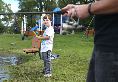 Candace H. Johnson-For Shaw Media Nicholas Edelstein, 7, of Ingleside fishes with his father, Brian, during the 3rd Annual Fox Lake Fish Fest Youth Fishing Derby at Lakefront Park in Fox Lake. (9/20/19)