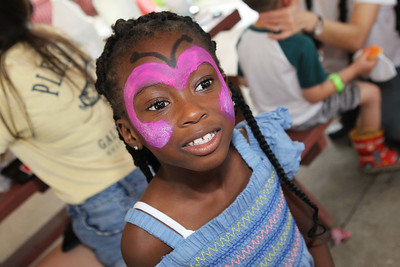 Candace H. Johnson-For Shaw Media Carmen Ablorh, 6, of Gurnee shows off her butterfly face painting during Fall on the Farm at Lambs Farm in Libertyville. (9/21/19)