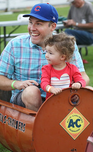Candace H. Johnson-For Shaw Media Justin Borawski, of Arlington Heights and his daughter, Lilly, 2, enjoy a barrel train ride during Fall on the Farm at Lambs Farm in Libertyville. (9/21/19)