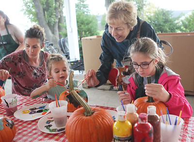Candace H. Johnson-For Shaw Media Sharon Byrne, of Vernon Hills and her daughter, Isley, 3, paint pumpkins with Peyton Teipel, 9, of Mundelein and grandmother, Valerie Teipel, of Lindenhurst during Fall on the Farm at Lambs Farm in Libertyville. (9/21/19)