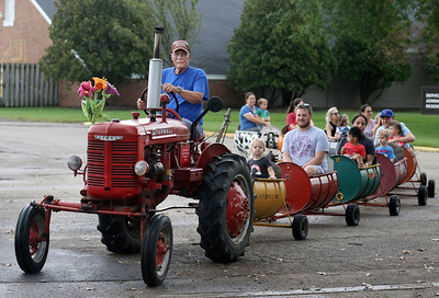 Candace H. Johnson-For Shaw Media Al Scales, of Gurnee with the Lake County Farm Heritage Association drives a 1947 McCormick Farmall A tractor as he gives visitors a ride on a barrel train during Fall on the Farm at Lambs Farm in Libertyville. (9/21/19)