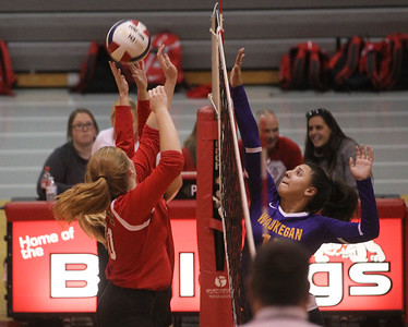 Candace H. Johnson-For Shaw Media Grant's Taylor Fruehling and Anelise Johnson block a hit by Waukegan's Mia Carani in the second set at Grant Community High School in Fox Lake. Grant won 25-17, 25-14. (9/24/19)