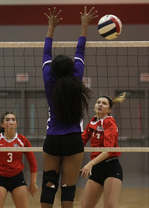 Candace H. Johnson-For Shaw Media Grant's CeCe Palladino (#14) watches her attack get around the block by Waukegan's Raia Ahmed in the first set at Grant Community High School in Fox Lake. Grant won 25-17, 25-14. (9/24/19)