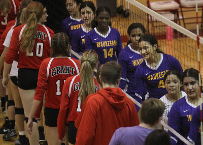 Candace H. Johnson-For Shaw Media Grant's girls varsity volleyball team shake hands with Waukegan after their game at Grant Community High School in Fox Lake. Grant won 25-17, 25-14. (9/24/19)