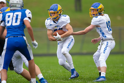 Johnsburg quarterback Ian Boal (right) hands off to Austin Gibb against Woodstock Saturday, September 28, 2019 in Woodstock. Johnsburg went on to get the conference win 31-28.
