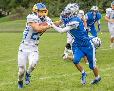Johnsburg's Jake McKinney (left) and Woodstock's Zach Adams (right) battle it out Saturday, September 28, 2019 in Woodstock. Johnsburg went on to get the conference win 31-28.