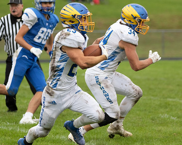 Johnsburg's Jake McKinney breaks away against Woodstock Saturday, September 28, 2019 in Woodstock. Johnsburg went on to get the conference win 31-28.