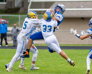Woodstock's Nathan Archambeau makes an incredible catch between Johnsburg defenders Saturday, September 28, 2019 in Woodstock. Johnsburg went on to win 31-28.