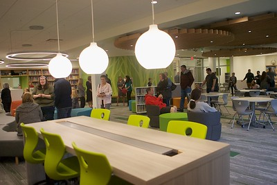 Students and parents explore the new library at Prairie Grove School on Sept. 29.