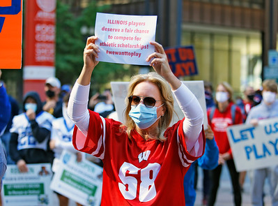 """Kristin Maskalunas from Chicago displays a sign in support of the """"Let Us Play"""" rally for a return to high school sports on Saturday, September 19, 2020 at the James R. Thompson Center in Chicago, IL."""