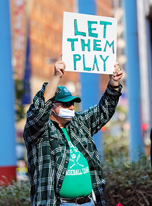 """Fred Kahn of Park Ridge holds up a sign of support at the """"Let Us Play"""" rally in support of a return to high school sports on Saturday, September 19, 2020 at the James R. Thompson Center in Chicago, IL."""