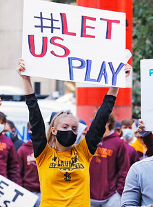 """Ella Woltman a St. Laurence high school freshman participates in the """"Let Us Play"""" rally in support of a return to high school sports on Saturday, September 19, 2020 at the James R. Thompson Center in Chicago, IL. Ms. Woltman was also a speaker at the event."""