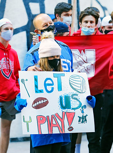 """Demonstrators listen to a speaker at the """"Let Us Play"""" rally in support of a return to high school sports on Saturday, September 19, 2020 at the James R. Thompson Center in Chicago, IL."""