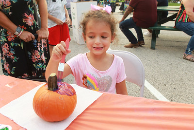Candace H. Johnson-for Shaw Media Adalyn Schartner, 5 of Lake Villa paints a pumpkin during the Celebration of Fall event on Cedar Avenue in Lake Villa.  (9/11/21)