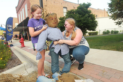 Candace H. Johnson-for Shaw Media Phoebe Draper, 12, of Round Lake Beach and Cindy Abbinanti, of Lake Villa make a scarecrow during the Celebration of Fall event on Cedar Avenue in Lake Villa.  (9/11/21)