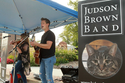 Candace H. Johnson-for Shaw Media Colleen Kuraszek and Judson Brown, with the Judson Brown Band, perform popular music during the Celebration of Fall event on Cedar Avenue in Lake Villa.  (9/11/21)