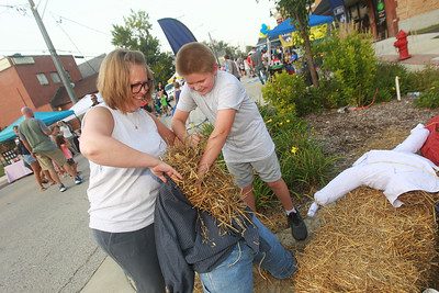 Candace H. Johnson-for Shaw Media Jennifer Drennan, of Antioch and her son, Tyler, 11, make a scarecrow during the Celebration of Fall event on Cedar Avenue in Lake Villa.  (9/11/21)