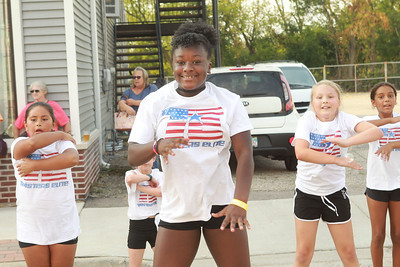 Candace H. Johnson-for Shaw Media Lailah Spark, 10, of Gurnee (center) and others with Twisters Elite, perform a dance routine during the Celebration of Fall event on Cedar Avenue in Lake Villa.  (9/11/21)