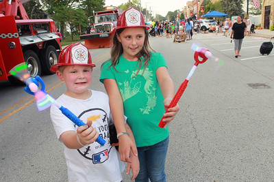 Candace H. Johnson-for Shaw Media Max Theis, 6, of Lake Villa and his sister, Mia, 9, show off their glow wands during the Celebration of Fall event on Cedar Avenue in Lake Villa.  (9/11/21)