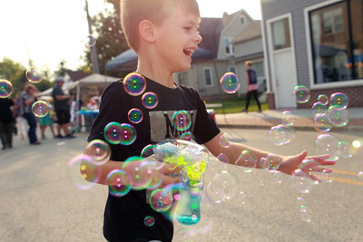 Candace H. Johnson-for Shaw Media Anthony Rendall, 4, of Lake Villa runs with a bubble wand during the Celebration of Fall event on Cedar Avenue in Lake Villa.  (9/11/21)